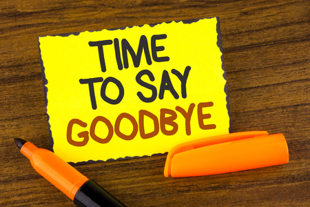 Conceptual hand writing showing Time To Say Goodbye. Business photo showcasing Separation Moment Leaving Breakup Farewell Wishes Ending written Yellow Sticky note paper wooden background Marker