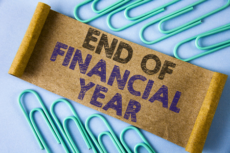 Text sign showing End Of Financial Year. Conceptual photo Taxes time accounting June database cost Sheets written Folded Cardboard paper piece plain blue background within Paper Pins.