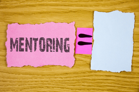 Writing note showing  Mentoring. Business photo showcasing To give advice or support to a younger less experienced person written Tear Sticky note paper wooden background Equation Space.
