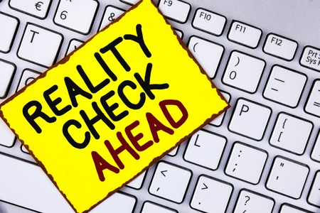Handwriting text Reality Check Ahead. Concept meaning Unveil truth knowing actuality avoid being sceptical written Yellow Sticky Note Paper placed the Laptop.