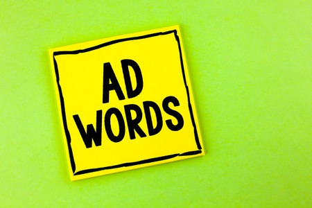 Handwriting text Ad Words. Concept meaning Advertising a business over first of internet search results written Yellow Sticky Note Paper the plain background.
