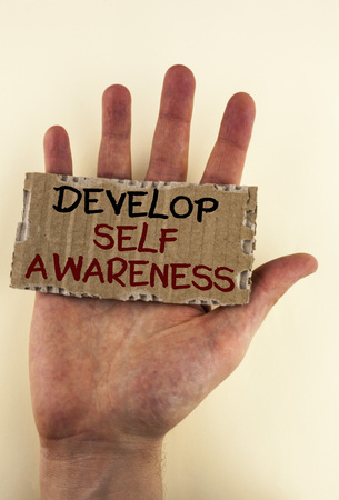 Writing note showing  Develop Self Awareness. Business photo showcasing improve your Informations about surrounding events written Tear Cardboard Piece placed Hand the plain background.