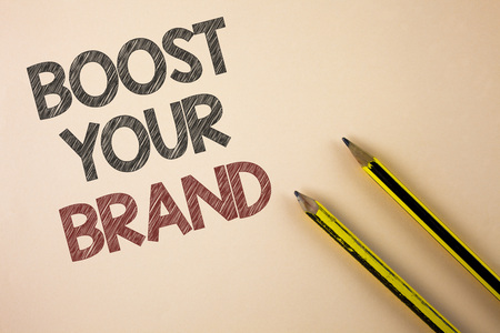 Writing note showing  Boost Your Brand. Business photo showcasing improve your models name in your field overcome competitors written Plain background Pencils next to it.
