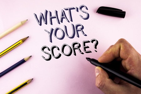Word writing text What Is Your Score Question. Business concept for Tell Personal Individual Rating Average Results written by Man plain background holding Marker Pencils next to it. Stock Photo