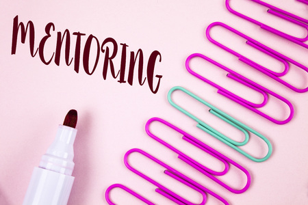Writing note showing  Mentoring. Business photo showcasing To give advice or support to a younger less experienced person written Plain Pink background Marker and Paper Pins next to it.