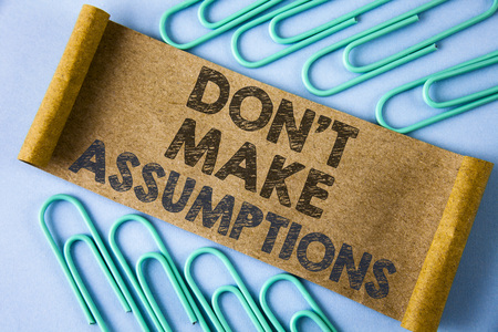 Text sign showing Do not Make Assumptions. Conceptual photo predict events future without clue Alternative Facts written Folded Cardboard paper piece plain blue background within Paper Pins.