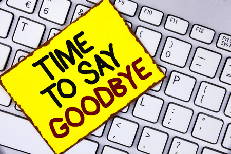 Handwriting text Time To Say Goodbye. Concept meaning Separation Moment Leaving Breakup Farewell Wishes Ending written Yellow Sticky Note Paper placed the Laptop.