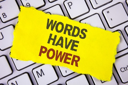 Text sign showing Words Have Power. Conceptual photo Statements you say have the capacity to change your reality written Tear Sticky note paper placed White Keyboard. Top View. Foto de archivo