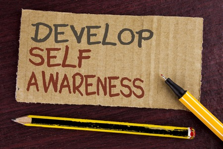Text sign showing Develop Self Awareness. Conceptual photo improve your Informations about surrounding events written Cardboard Piece wooden background Led Pen and Pencil next to it.