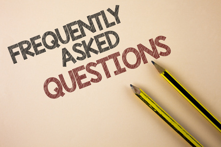 Writing note showing  Frequently Asked Questions. Business photo showcasing most common inquiries Informations Help Guide written Plain background Pencils next to it.