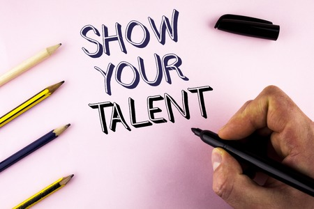 Word writing text Show Your Talent. Business concept for Demonstrate personal skills abilities knowledge aptitudes written by Man plain background holding Marker Pencils next to it.