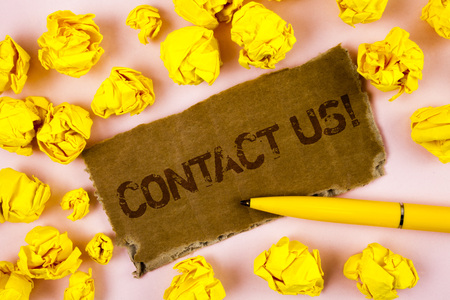 Conceptual hand writing showing Contact Us Motivational Call. Business photo text Reaching us will make your dreams into reality written Tear Cardboard piece plain background Paper Balls Pen