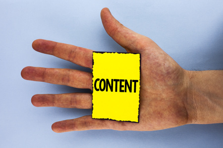 Handwriting text Content. Concept meaning Website containing exclusive and containing rich information written Yellow Sticky Note Paper placed Hand the plain background.