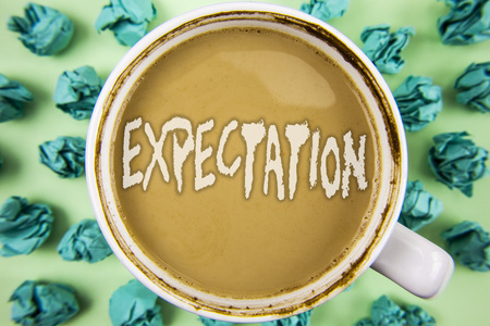 Word writing text Expectation. Business concept for Meteorological research analyst predicts weather forecast written Tea in White Cup within Crumpled Paper Balls plain background. 版權商用圖片