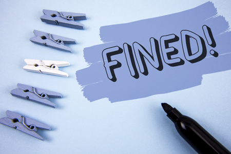 Conceptual hand writing showing Fined Motivational Call. Business photo text No penalty charge for late credit card bill payment written Painted background wooden Clips and Marker next to it. Foto de archivo