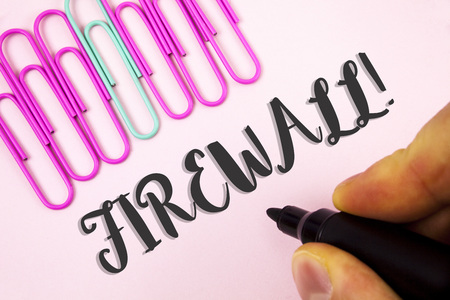 Word writing text Firewall Motivational Call. Business concept for Malware protection prevents internet frauds written by Man holding Marker Plain Pink background Paper Pins next to it. Foto de archivo