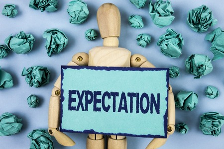 Word writing text Expectation. Business concept for Meteorological research analyst predicts weather forecast written Sticky note paper within Paper Balls plain background Jointed Toy Stock Photo