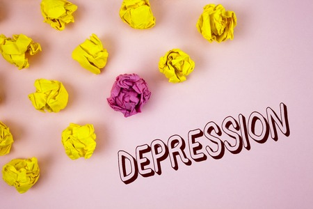 Text sign showing Depression. Conceptual photo Work stress with sleepless nights having anxiety disorder written plain Pink background Crumpled Paper Balls next to it. Stock Photo