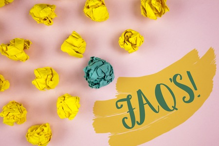 Handwriting text writing FaqS Motivational Call. Concept meaning Multiple questions answered for online product written Painted background Crumpled Paper Balls next to it. Stock Photo