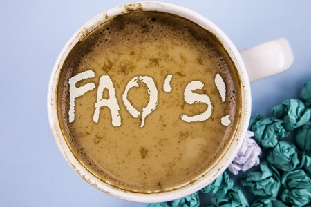 Conceptual hand writing showing Faq'S Motivational Call. Business photo showcasing Multiple questions answered for online product written Coffee in Cup plain background Paper Balls.