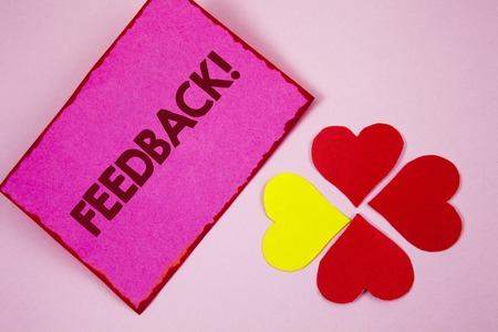 Word writing text Feedback Motivational Call. Business concept for Rating an economical local grocery store written Sticky note paper plain Pink background Paper Hearts next to it. Stock Photo