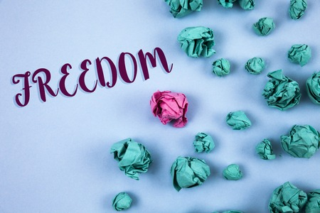 Conceptual hand writing showing Freedom. Business photo text Going out for a vacation, students having liberty to go world tour written Plain Blue background Paper Balls next to it.