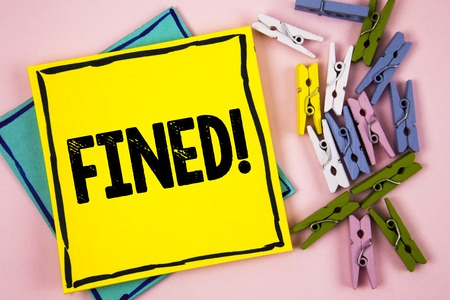 Text sign showing Fined Motivational Call. Conceptual photo No penalty charge for late credit card bill payment written Sticky Note Paper plain background Paper Balls and Wooden Clips.