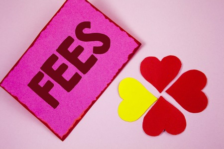 Word writing text Fees. Business concept for Online creative agency charges product components hourly costs written Sticky note paper plain Pink background Paper Hearts next to it.