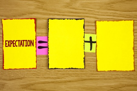 Handwriting text writing Expectation. Concept meaning Meteorological research analyst predicts weather forecast written Sticky Note Paper wooden background. Equation with Plus sign.