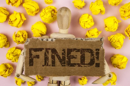 Conceptual hand writing showing Fined Motivational Call. Business photo showcasing No penalty charge for late credit card bill payment written Tear Cardboard piece pink background wooden Toy Foto de archivo