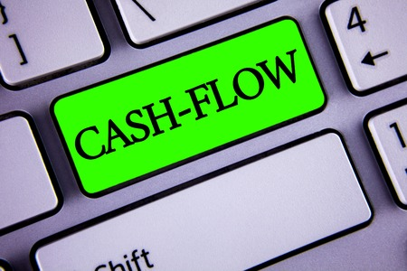 Handwriting text Cash-Flow. Concept meaning Virtual movement of money by company finance department statistics written Green Key Button White Keyboard with copy space. Top view.