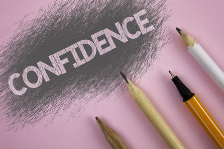 Text sign showing Confidence. Conceptual photo Never ever doubting your worth, inspire and transform yourself written Pink background Pen and pencils next to it.