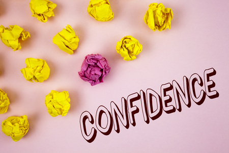 Text sign showing Confidence. Conceptual photo Never ever doubting your worth, inspire and transform yourself written plain Pink background Crumpled Paper Balls next to it.