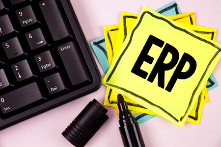 Word writing text Erp. Business concept for Enterprise resource planning with automate back office functions written Sticky Note paper plain background Marker and Keyboard next to it.