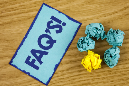 Word writing text FaqS Motivational Call. Business concept for Multiple questions answered for online product written Sticky Note paper wooden background Paper Balls next to it.