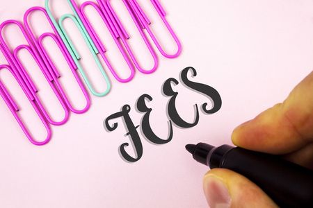 Word writing text Fees. Business concept for Online creative agency charges product components hourly costs written by Man holding Marker Plain Pink background Paper Pins next to it.
