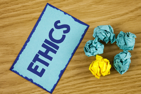 Word writing text Ethics. Business concept for Maintaining equality balance among others having moral principles written Sticky Note paper wooden background Paper Balls next to it. Reklamní fotografie