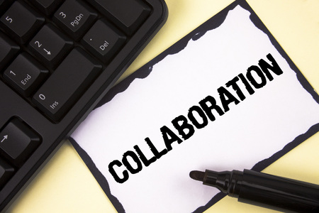 Conceptual hand writing showing Collaboration. Business photo text Global industries partnership with teamwork to help others win written Sticky Note paper plain background Marker Keyboard.