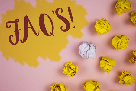 Word writing text FaqS Motivational Call. Business concept for Multiple questions answered for online product written Painted background Crumpled Paper Balls next to it.