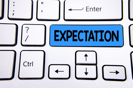 Writing note showing  Expectation. Business photo showcasing Meteorological research analyst predicts weather forecast written Blue Key Button White Keyboard with copy space. Top view.