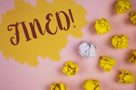 Word writing text Fined Motivational Call. Business concept for No penalty charge for late credit card bill payment written Painted background Crumpled Paper Balls next to it.