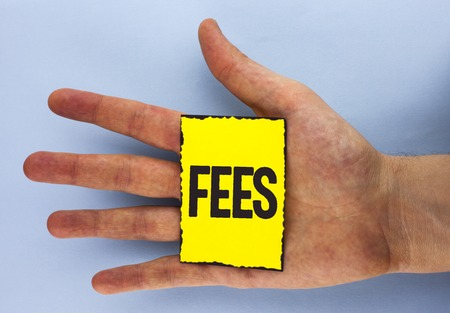 Conceptual hand writing showing Fees. Business photo showcasing Online creative agency charges product components hourly costs written Yellow Sticky Note Paper plain background Hand.