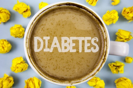 Conceptual hand writing showing Diabetes. Business photo text Medical condition diagnosed with increased high level sugar written Coffee in Cup within Paper Balls plain background. Banque d'images