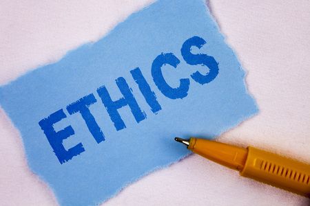 Text sign showing Ethics. Conceptual photo Maintaining equality balance among others having moral principles written Tear Blue Sticky note paper plain background Pen next to it.