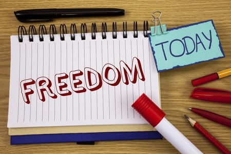 Conceptual hand writing showing Freedom. Business photo text Going out for a vacation, students having liberty to go world tour written Noteoad wooden background Today Pen Pencil next to it Stock Photo