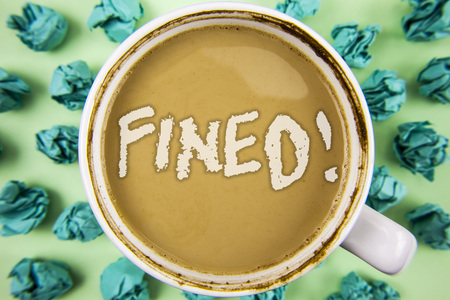 Word writing text Fined Motivational Call. Business concept for No penalty charge for late credit card bill payment written Tea in White Cup within Crumpled Paper Balls plain background.