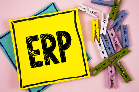 Text sign showing Erp. Conceptual photo Enterprise resource planning with automate back office functions written Sticky Note Paper plain background Paper Balls and Wooden Clips. Stock Photo