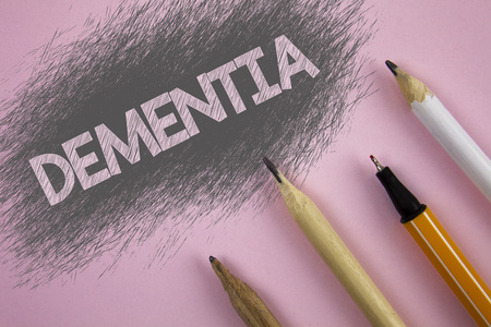 Text sign showing Dementia. Conceptual photo Long term memory loss sign and symptoms made me retire sooner written Pink background Pen and pencils next to it.