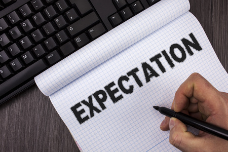 Conceptual hand writing showing Expectation. Business photo text Meteorological research analyst predicts weather forecast written by Marker in Hand Notebook wooden background Keyboard Stock Photo
