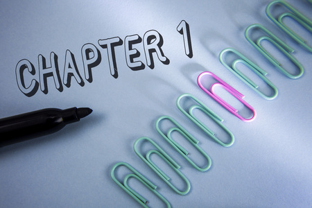 Handwriting text Chapter 1. Concept meaning Starting something new or making the big changes in one s journey written Plain Blue background Paper Clips and Marker next to it. Stock Photo